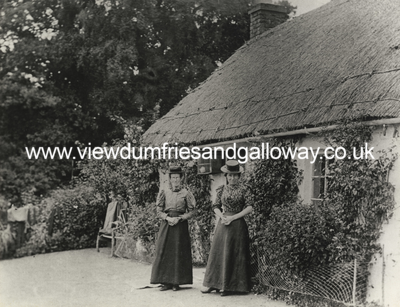 Thatched cottage with two ladies