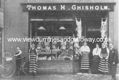 Thomas H Chisholm's shop and staff