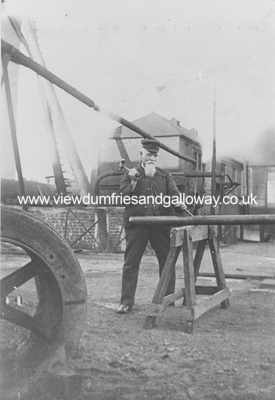 Railwayman working with a hammer and plunger