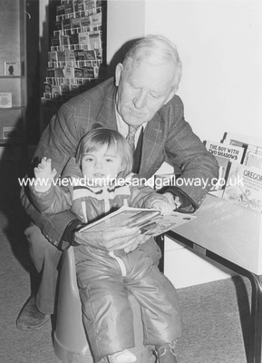 A young reader with Mr James Rae