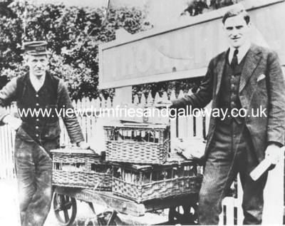 Station staff with baskets of poultry