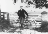 Unidentified man with bicycle